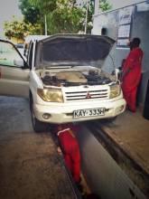 One of many bush mechanics trying to fix my car in Kenya