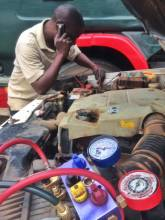One of many bush mechanics trying to fix my car in Zambia