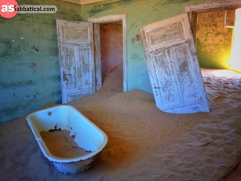 abandoned house filled with sand in the ghost town of kolmanskop