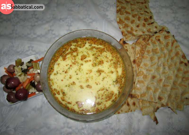 Abgoosht is an Iranian stew served on stoneware crocks. It is made with lamb and vegetables (chickpeas, beans, tomatoes, etc.). Turmeric and dried lime are used for flavor.