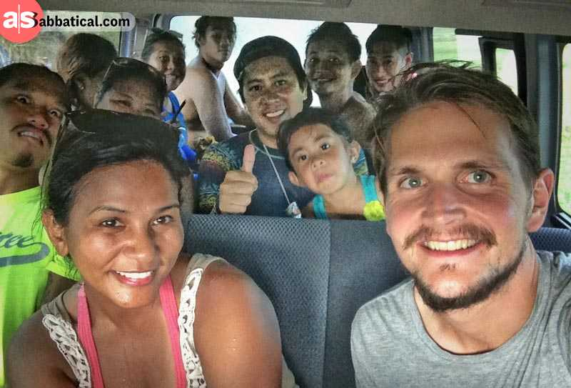 Adrian travelling in a small bus together with a group of Filipinos