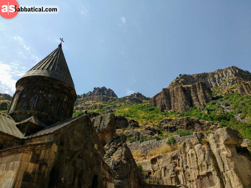 Armenia is full of breathtaking places like this monastery towered by the cliffs above.