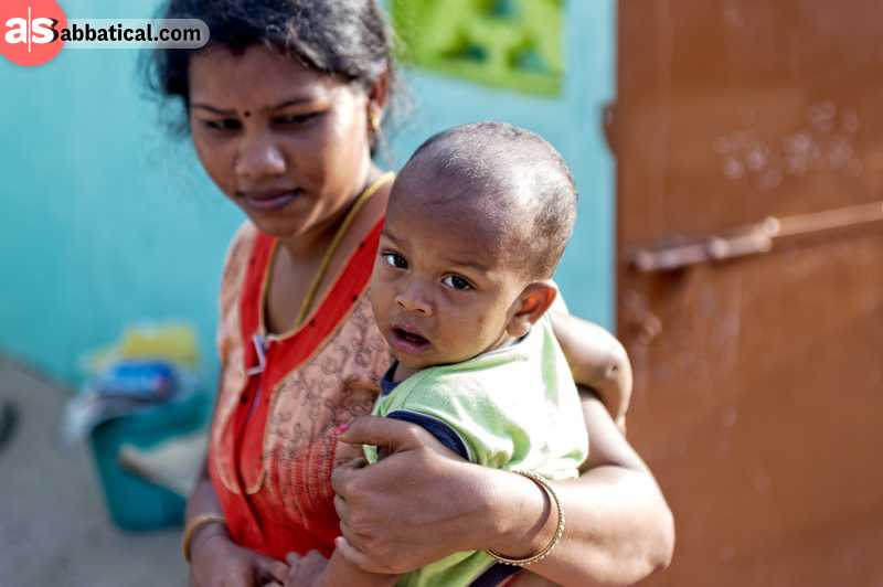 In India, specifically Maharashtra, babies are tossed from to roof to the crowd holding a blanket to catch the baby. This is one of the most shocking Indian traditions that should bring good luck to the babies.