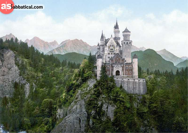 Castle Neuschwanstein with idyllic Bavarian Alps in the background.