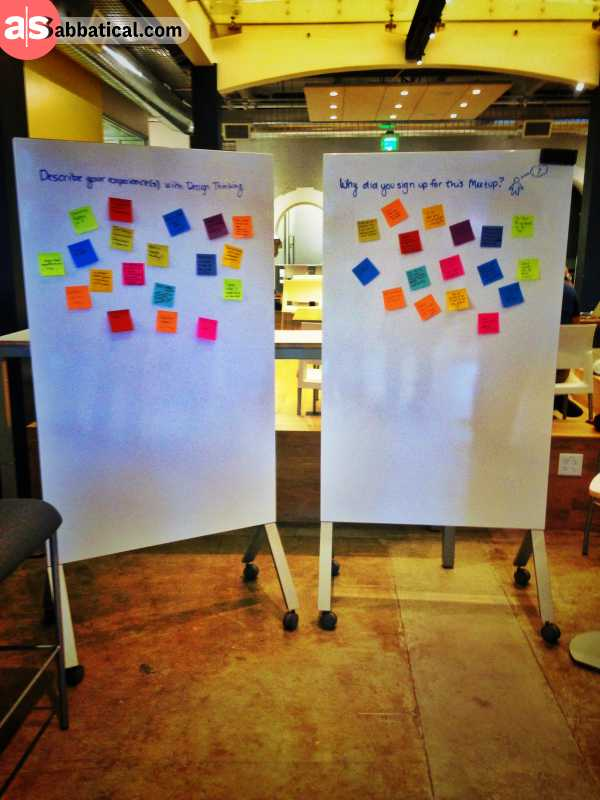 two large white boards with sticky notes representing your social media schedule