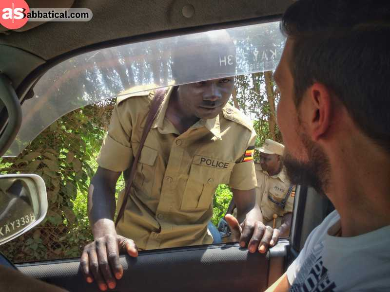 Friendly greeting a police officer on the border from Kenya to Uganda