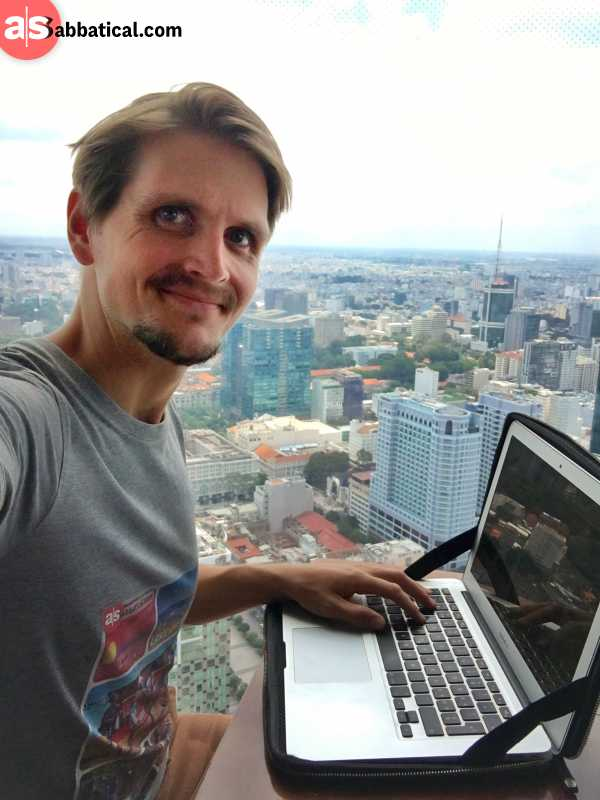 me working from a rooftop bar in ho chi minh city on my personal travel blog
