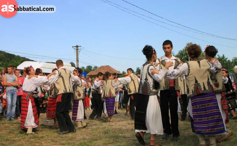 Romanian people during their traditional dance