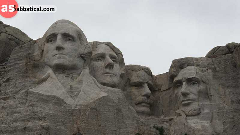 The Founding Fathers are carved in Mt.Rushmore, with George Washington looking proud in front.