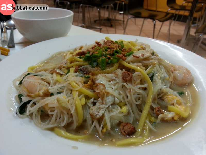Hokkien Prawn Mee is a combination of rice noodles and fried egg noodles cooked in a rich prawn stock.