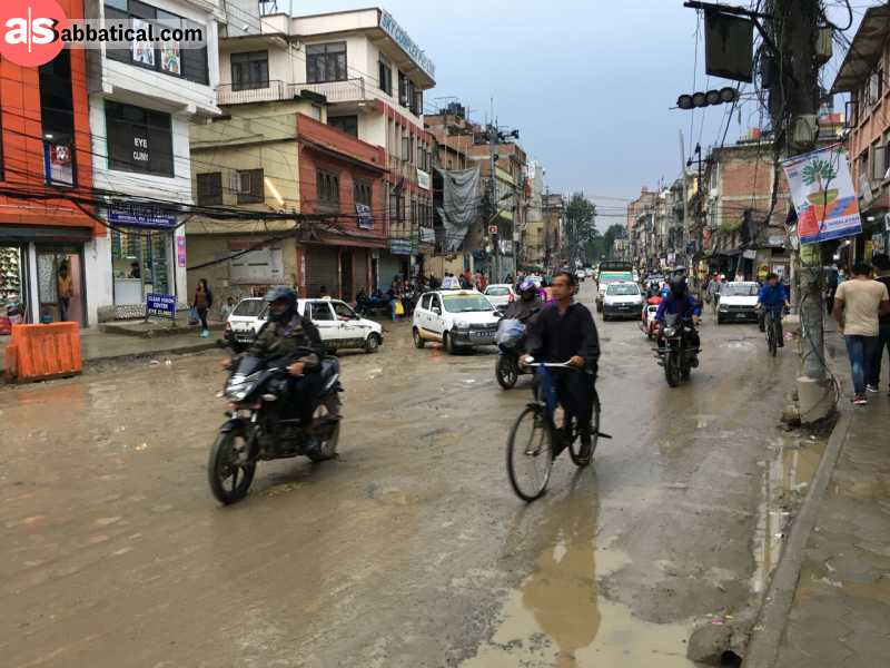 STreets of Kathmandu are crowded with many vehicle types.