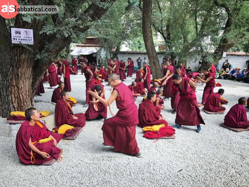 Sera Monastery is one of the three most important monasteries in Tibet, known for its Debate Courtyard, where monks practice critical debates.