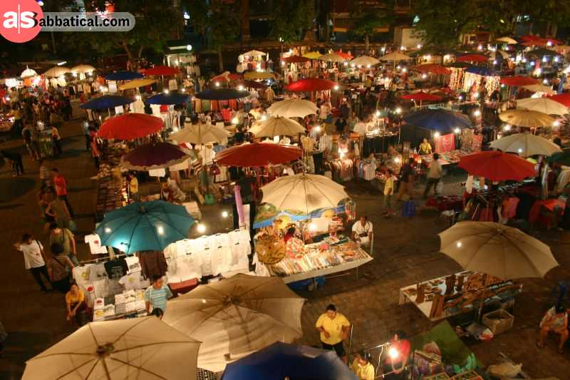 Chian Mai's Sunday Night Market is a perfect place to try out the authentic Thai cuisine or check out the local shops with local goods and valuables.