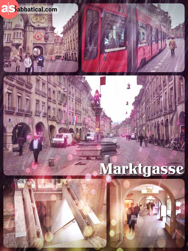 Marktgasse - walking through the old romantic shopping street of Bern on cobble stone