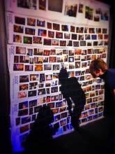 huge photo wall representing the usage of photo album maker for your travel memories