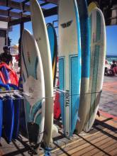 surfboards ready to hit the waves in cape town, south africa