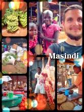 Masindi - eating lunch at the local market after having a forced stop to visit a mechanic