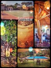 Utengule Coffee Lodge - camping on the helicopter landing place of a luxury colonial coffee plantage