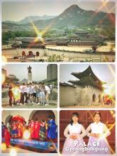 Gyeongbokgung Palace - many Koreans in traditional dresses at the ancient royal palace in Seoul