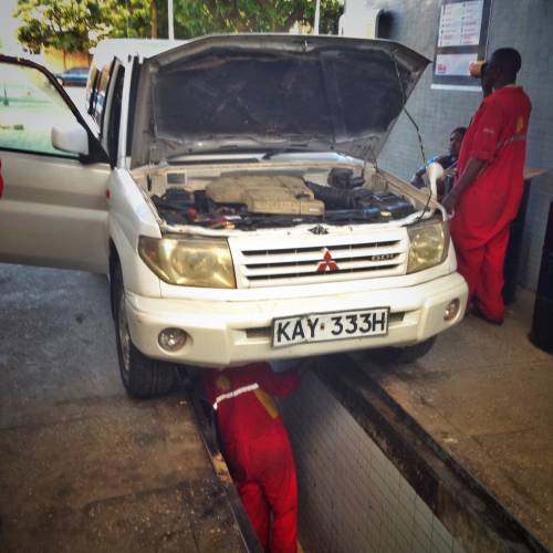 One of many bush mechanics trying to fix my car in Kenya