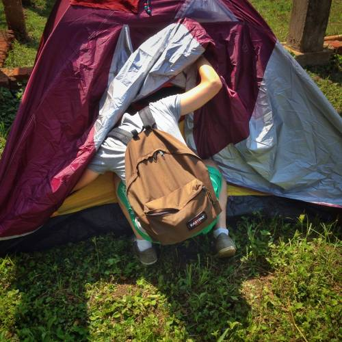 save money while living abroad by using couchsurfing or camping