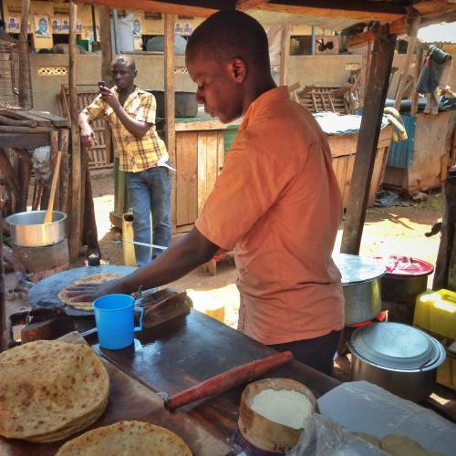 Eating street food (a rolex) on a market in Uganda